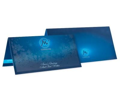 Лице и гръб на синя поздравителна картичка за Коледните и Новогодишни празници