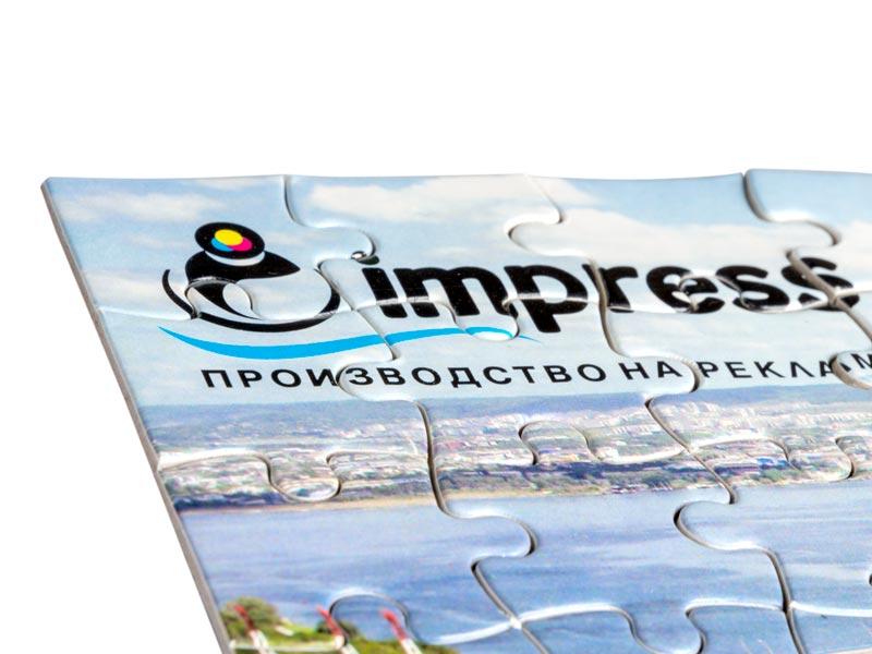 сглобени части от пъзел с лого IMPRESS